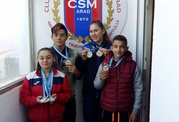 """CSM Arad își promovează campionii continentali de la haltere și tenis de masă: """"Ce sentiment când îți cântă imnul!"""""""